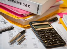 calculator 220x162 - Should Countries Lower Taxes to Attract Investments?